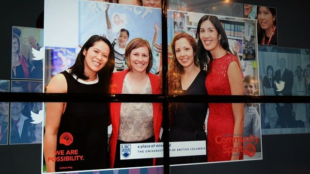 Photo of four women projected on a big screen via SnapCast