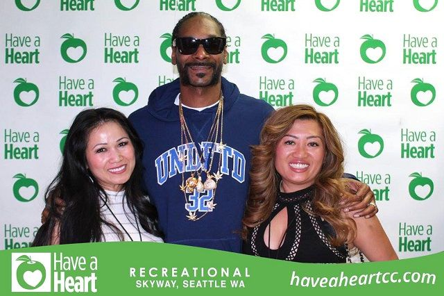 Fans pose for a picture with Snoop Dogg