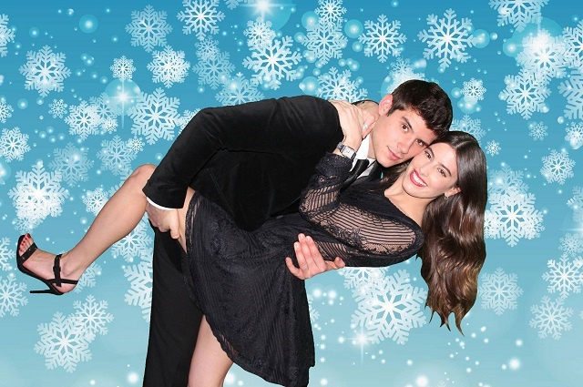 couple posing against a snowflake green screen