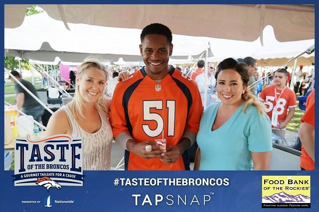 NFL fans pose with Denver Broncos player, Todd Davis.