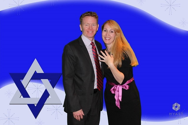 Couple standing against a Star of David green screen