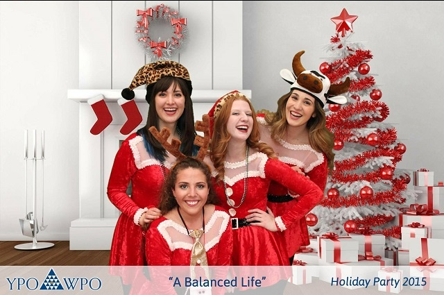 Four girls wearing Santa Claus-style dresses