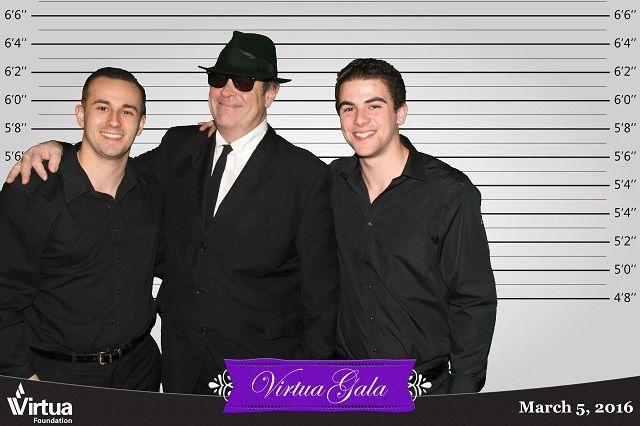 Dan Aykroyd poses with his fans for a TapSnap photo booth picture