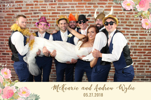 bride and groomsmen posing